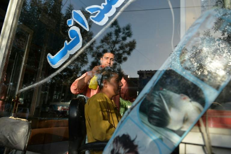 During the Taliban's 1996 -2001 rule, the hardliners banned flamboyant hairstyles and insisted men grow beards (AFP/Hoshang Hashimi)