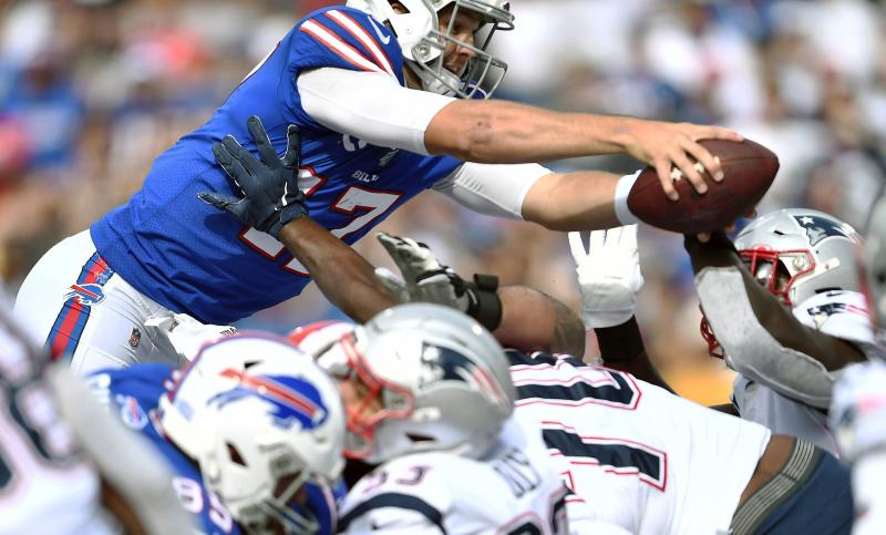 Up and over: Buffalo Bills quarterback Josh Allen scored a touchdown in the third quarter, the first touchdown allowed by the New England Patriots defense this season. (AP)