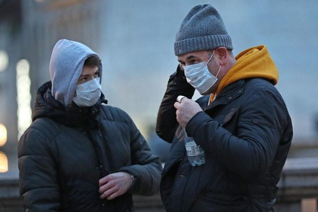 People wearing face masks in Trafalgar Square, London (Yui Mok/PA)