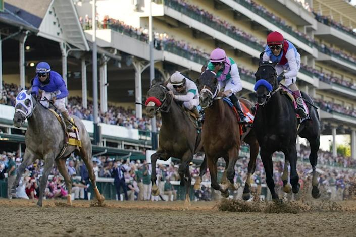 Medina Spirit, right, leads Mandaloun, Hot Rod Charlie and Essential Quality to the finish line at the Kentucky Derby.