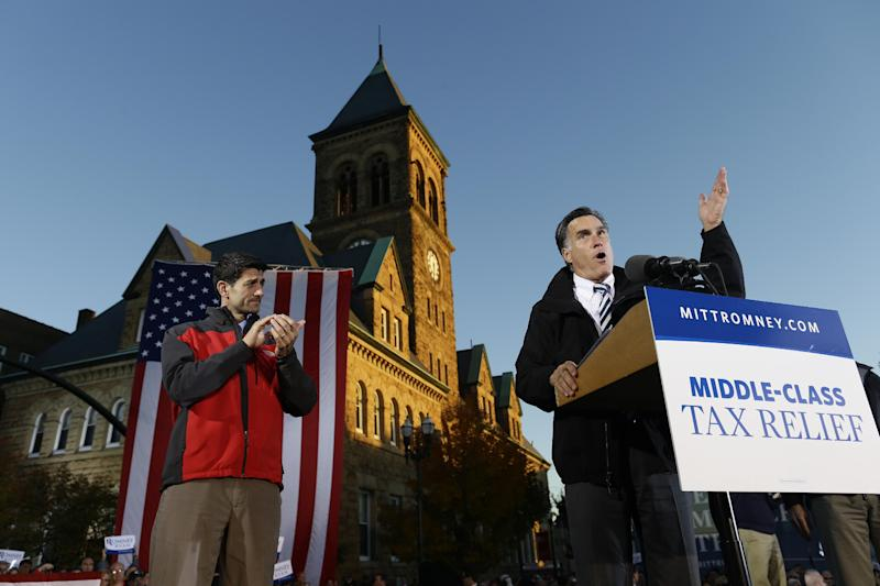 In this photo taken Oct. 12, 2012, Republican presidential candidate and former Massachusetts Gov. Mitt Romney and Republican vice presidential candidate, Rep. Paul Ryan, R-Wis., campaigns in Lancaster, Ohio. It's either candidate's race to win as Obama and Romney prepare to dig in for their second debate Tuesday night, Oct. 16, 2012, with just three weeks to go until the election and voting already well under way in many states. (AP Photo/Charles Dharapak)