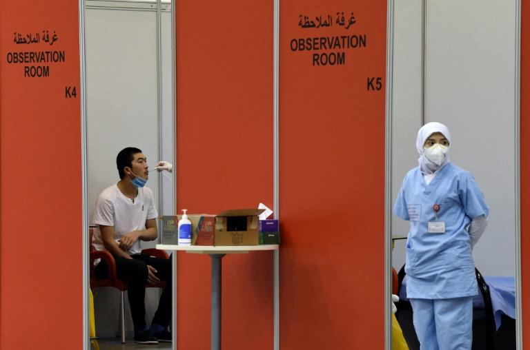 'Service to humanity': Volunteers in Bahrain sign up for vaccine trial