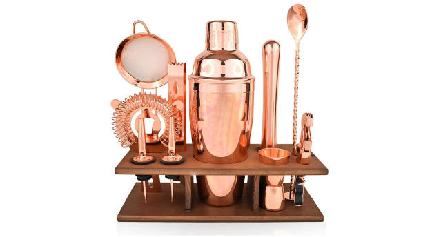 11-piece copper bartender kit in rose gold with shaker, muddler, pourers, strainer & twisted bar spoon (Photo: J&A Homes)