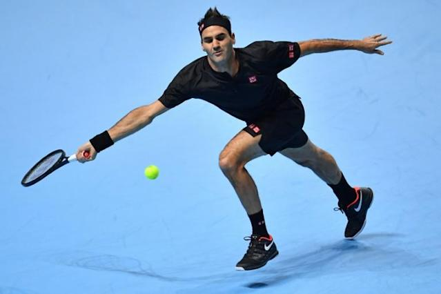Roger Federer in action against Novak Djokovic at the ATP Finals (AFP Photo/Ben STANSALL)