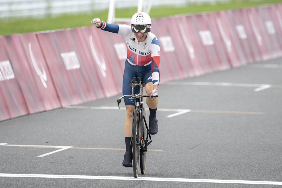 Britain's Sarah Storey crosses the finish line in the women's cycling road individual C5 time trial during the Tokyo 2020 Paralympic Games at the Fuji International Speedway in Oyama, Japan, on August 30, 2021. (AFP via Getty Images)