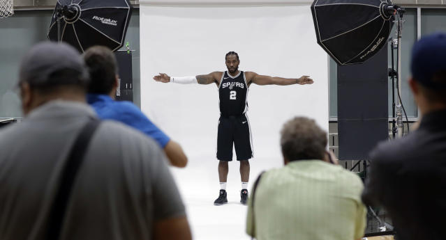 "<a class=""link rapid-noclick-resp"" href=""/nba/teams/sas/"" data-ylk=""slk:San Antonio Spurs"">San Antonio Spurs</a> star <a class=""link rapid-noclick-resp"" href=""/nba/players/4896/"" data-ylk=""slk:Kawhi Leonard"">Kawhi Leonard</a> poses for the cameras on media day. (AP)"
