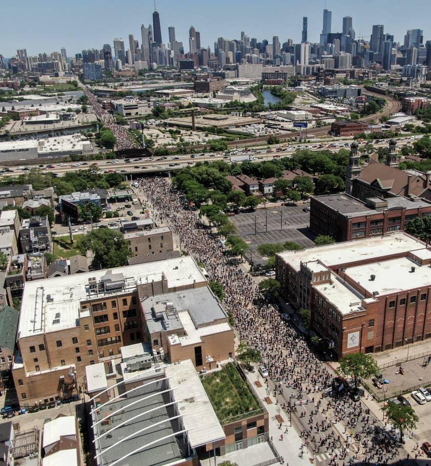 People marching in Chicago on Saturday (EPA/Tannen Maury)