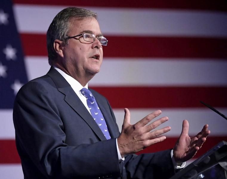 FILE - This Aug. 9, 2013 file photo shows former Florida Gov. Jeb Bush speaking in Chicago. Critics are relentless in warning about what they see as the folly of the new Common Core academic standards. The standards were written in private and never tested in real classrooms, they say. Educators aren't familiar enough with the standards to use them. They'll cost billions to put into place. (AP Photo/M. Spencer Green, File)