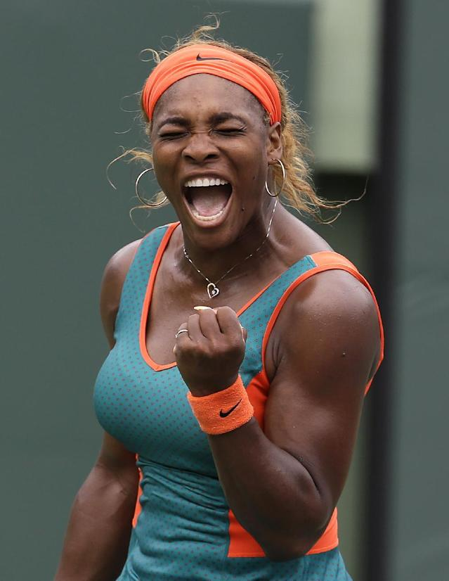 Serena Williams, reacts after breaking service against Li Na, of China, in the first set during the final at the Sony Open Tennis tournament, Saturday, March 29, 2014, in Key Biscayne, Fla. (AP Photo/Lynne Sladky)