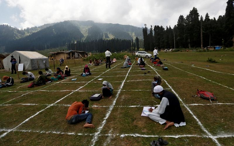 Here's a look at the open air school setup in Kashmir - Reuters