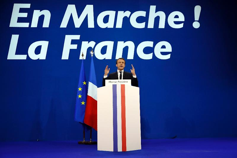 French presidential election candidate would be the youngest leader in the country's history if he wins the second round on May 7 (AFP Photo/Patrick KOVARIK)