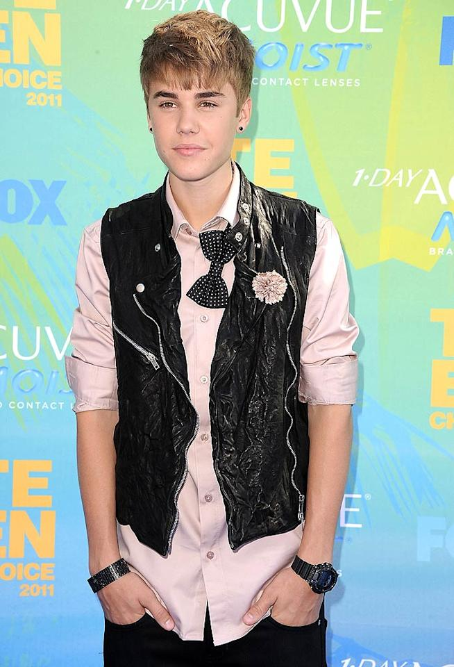 <strong>Justin Bieber:</strong> What a trendsetter! In a leather vest, bow tie, and pink button-down shirt, this 17-year-old superstar knows how to accessorize and wear a pop of color! (8/7/2011)