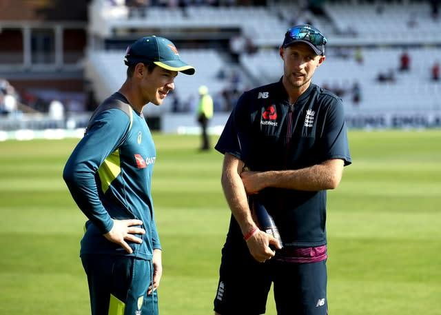 Tim Paine, right, insists he takes no pleasure from seeing opposite number Joe Root under pressure (Tim Goode/PA)