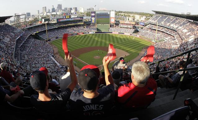 Atlanta Braves fans cheer during Game 2 of the National League Divisional Series against the Los Angeles Dodgers, Friday, Oct. 4, 2013, in Atlanta. (AP Photo/Dave Martin)