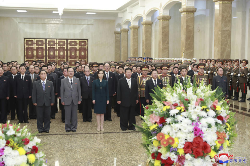 """In this photo provided by the North Korean government, North Korean leader Kim Jong Un, center right, and his wife Ri Sol Ju, center, left, visit the Kumsusan Palace of the Sun, marking the nation's 73rd anniversary in Pyongyang, North Korea, Thursday, Sept. 9, 2021. Independent journalists were not given access to cover the event depicted in this image distributed by the North Korean government. The content of this image is as provided and cannot be independently verified. Korean language watermark on image as provided by source reads: """"KCNA"""" which is the abbreviation for Korean Central News Agency. (Korean Central News Agency/Korea News Service via AP)"""