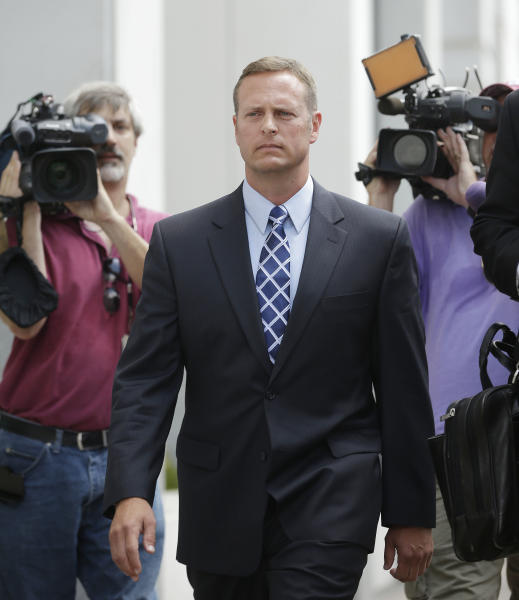 Lt. Col. Jeffrey Krusinski, who led the Air Force's Sexual Assault Prevention and Response unit, is surrounded by members of the media while leaving the Arlington County General District Court, Thursday, July 18, 2013 in Arlington, Va. Krusinski, who is accused of groping a woman in a Crystal City parking lot, had a scheduled trial on a charge of misdemeanor sexual battery, but Virginia prosecutors have dropped a sexual battery charge against him and substituted with a generic assault charge.(AP Photo/Pablo Martinez Monsivais)