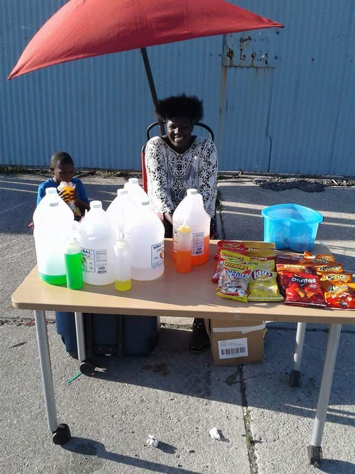 Shaday Gooden Brown managing her sale.