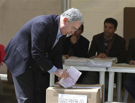 Former president of Colombia and candidate for the Senate Alvaro Uribe casts his vote during the congressional elections in Bogota March 9, 2014. REUTERS/John Vizcaino