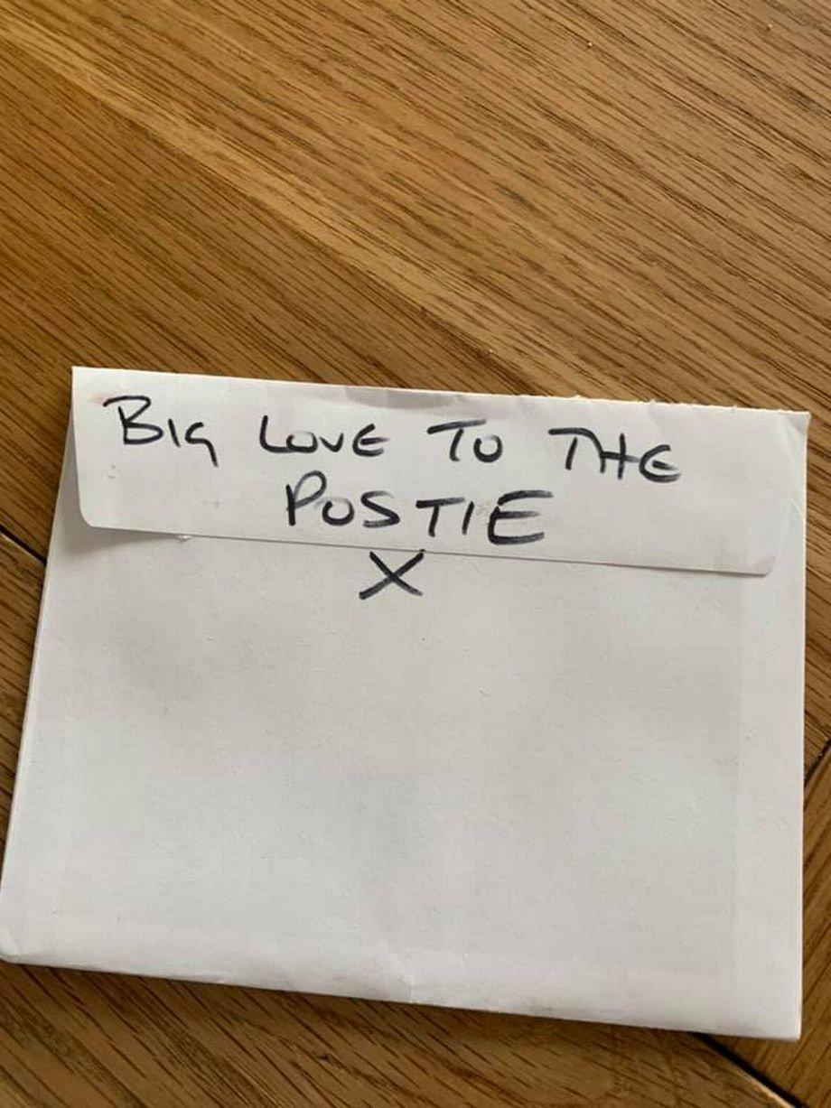 The letter also had 'big love to the postie X' written on the back. (SWNS)