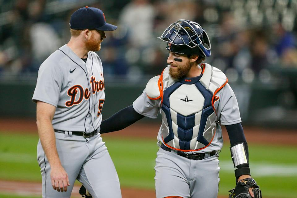 Detroit Tigers starting pitcher Spencer Turnbull (56) and catcher Eric Haase (13) walk back to the dugout following the fourth inning against the Seattle Mariners at T-Mobile Park on May 18, 2021.
