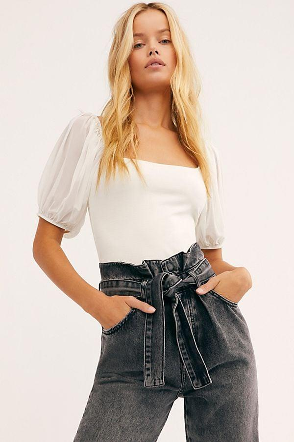"<p>This cute <a href=""https://www.popsugar.com/buy/Free-People-Puff-Sleeve-Cami-537624?p_name=Free%20People%20Puff%20Sleeve%20Cami&retailer=freepeople.com&pid=537624&price=40&evar1=fab%3Aus&evar9=46438356&evar98=https%3A%2F%2Fwww.popsugar.com%2Ffashion%2Fphoto-gallery%2F46438356%2Fimage%2F47077804%2FFree-People-Puff-Sleeve-Cami&list1=shopping%2Cwhite%2Ctops%2Csummer%2Cblouses%2Csummer%20fashion%2Cbest%20of%202020&prop13=api&pdata=1"" rel=""nofollow"" data-shoppable-link=""1"" target=""_blank"" class=""ga-track"" data-ga-category=""Related"" data-ga-label=""https://www.freepeople.com/shop/puff-sleeve-cami/?category=SEARCHRESULTS&amp;color=011"" data-ga-action=""In-Line Links"">Free People Puff Sleeve Cami</a> ($40) goes with everything.</p>"