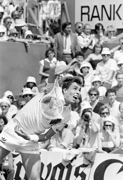 FILE - In this June 10, 1984, file photo, Ivan Lendl serves to John McEnroe in the men's finals at the French Open tennis tournament in Paris. Lendl beat McEnroe 3-6, 2-6, 6-4, 7-5, 7-5. This one marked a significant pivot in Lendl's career: He entered the day 0-4 in major finals but ended up with eight trophies. (AP Photo/Adam Stoltman, File)