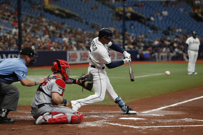 Tampa Bay Rays' Wander Franco (5) hits a single against the Minnesota Twins during the first inning of a baseball game on Saturday, Sept. 4, 2021, in St. Petersburg, Fla. (AP Photo/Scott Audette)