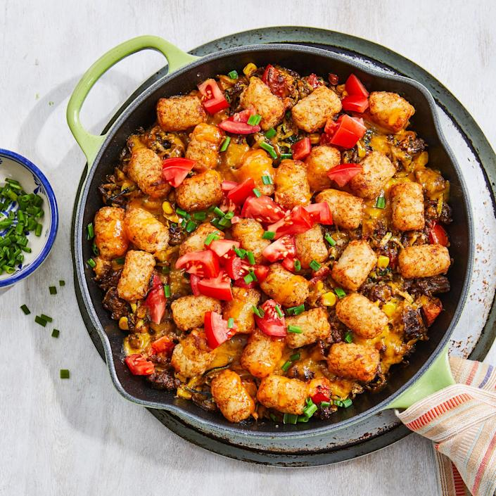 """<p>Casseroles can be for summer too! We packed this one with peak-season vegetables—corn, zucchini and tomatoes—then topped it with crispy tater tots and gooey melted cheese, making it a dinner winner. <a href=""""https://www.eatingwell.com/recipe/7901271/tater-tot-casserole-with-beef-corn-zucchini/"""" rel=""""nofollow noopener"""" target=""""_blank"""" data-ylk=""""slk:View Recipe"""" class=""""link rapid-noclick-resp"""">View Recipe</a></p>"""