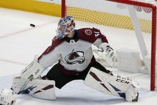 Colorado Avalanche goaltender Philipp Grubauer (31) makes a save against the Dallas Stars during the second period of an NHL hockey game in Dallas, Saturday, Dec. 28, 2019. (AP Photo/Michael Ainsworth)