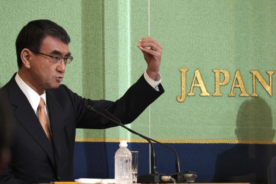 Taro Kono, the cabinet minister in charge of vaccinations, one of candidates for the presidential election of the ruling Liberal Democratic Party speaks during a debate session held by Japan National Press club Saturday, Sept. 18, 2021 in Tokyo. The contenders are also Fumio Kishida, former foreign minister, Sanae Takaichi, former internal affairs minister, and Seiko Noda, former internal affairs minister. (AP Photo/Eugene Hoshiko, Pool)
