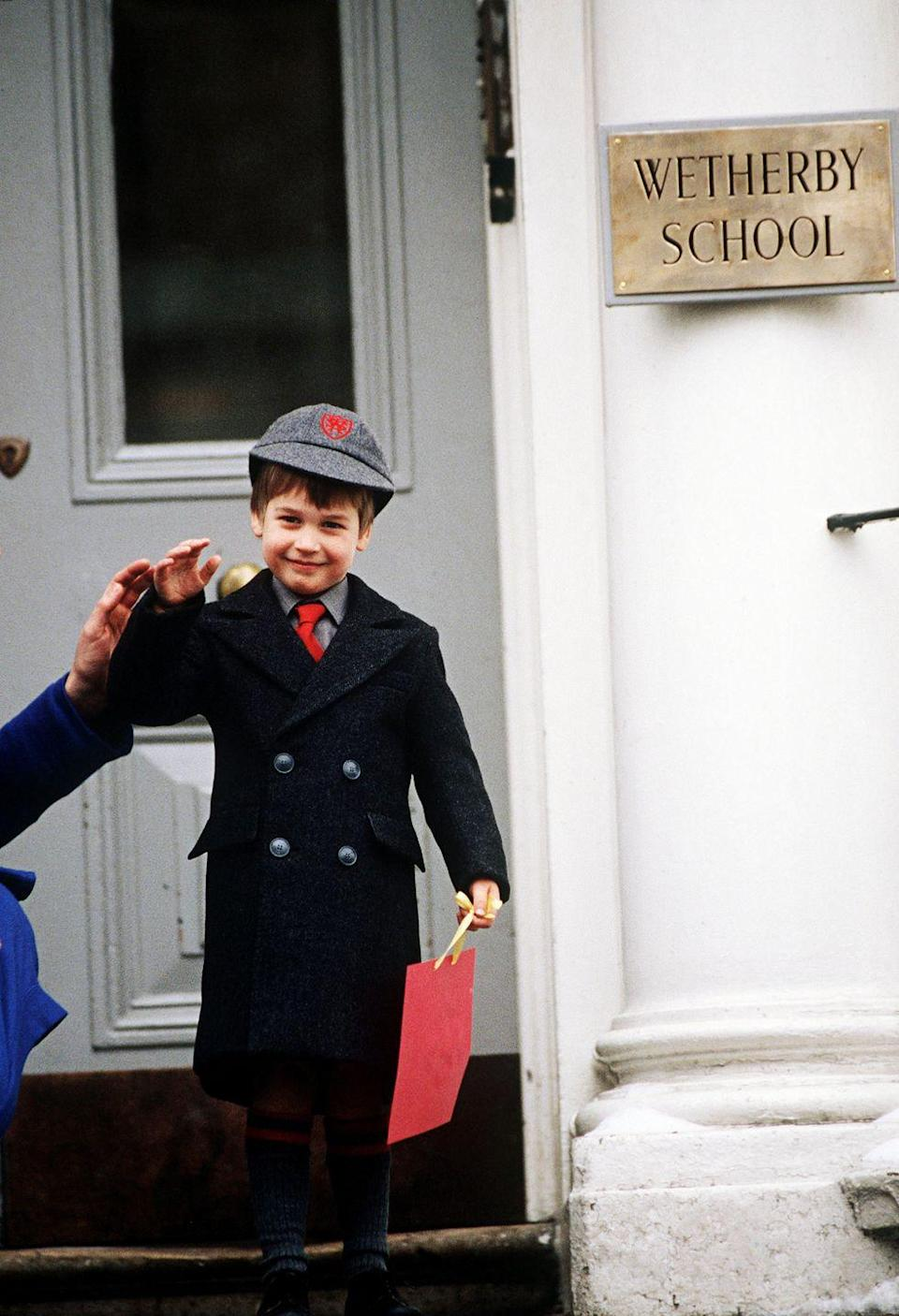 <p>Prince William poses outside the Wetherby School on his first day, providing incontrovertible proof that nobody does school uniforms like the English.</p>
