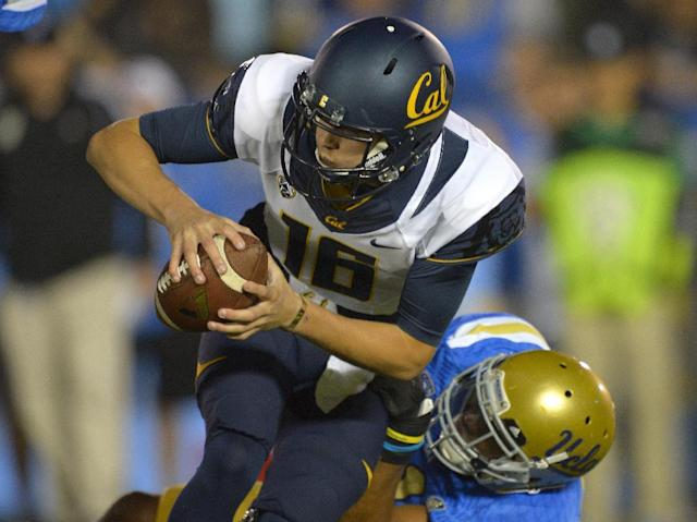 California quarterback Jared Goff, top, is sacked by UCLA linebacker Anthony Barr during the first half of their NCAA college football game, Saturday, Oct. 12, 2013, in Pasadena, Calif. (AP Photo/Mark J. Terrill)