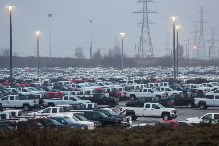 GM says it will bring back production of pickups at its Oshawa, Ontario assembly plant, which had been closed in December 2019. Hundreds of Silverado pickups assembled at the plant are seen here in November 2018 outside the facility