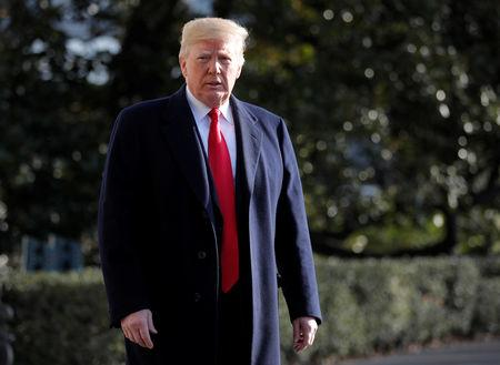 U.S. President Donald Trump walks to speak to the press before departing the South Lawn at the White House in Washington