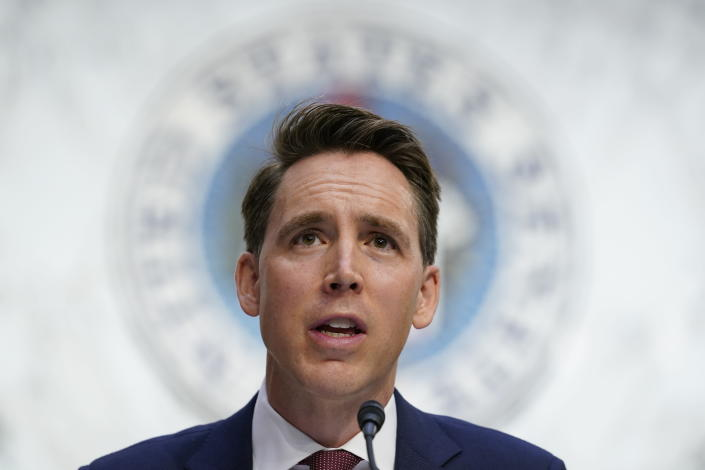 FILE - In this Oct. 12, 2020, file photo Sen. Josh Hawley, R-Mo., speaks during a confirmation hearing for Supreme Court nominee Amy Coney Barrett before the Senate Judiciary Committee on Capitol Hill in Washington. Hawley, says he will raise objections next week when the Congress meets to affirm President-elect Joe Biden's victory in the election, forcing House and Senate votes that are likely to delay — but in no way alter — the final certification of Biden's win.(AP Photo/Susan Walsh, Pool, File)