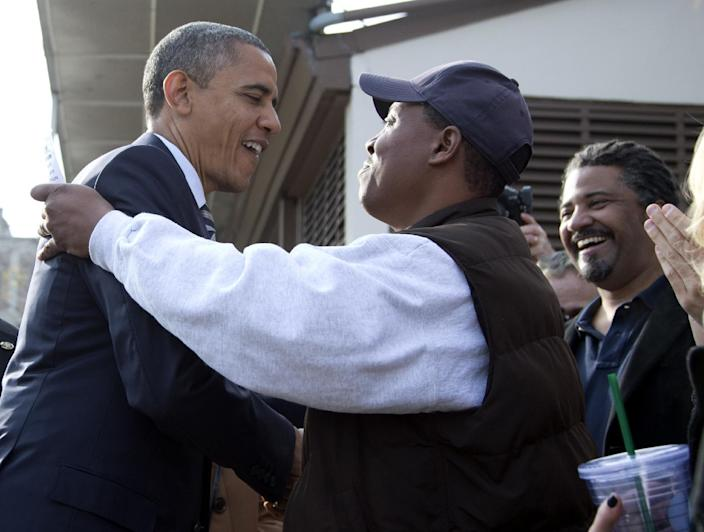 President Barack Obama visits with people outside a campaign office the morning of the 2012 election, Tuesday, Nov. 6, 2012, in Chicago. (AP Photo/Carolyn Kaster)