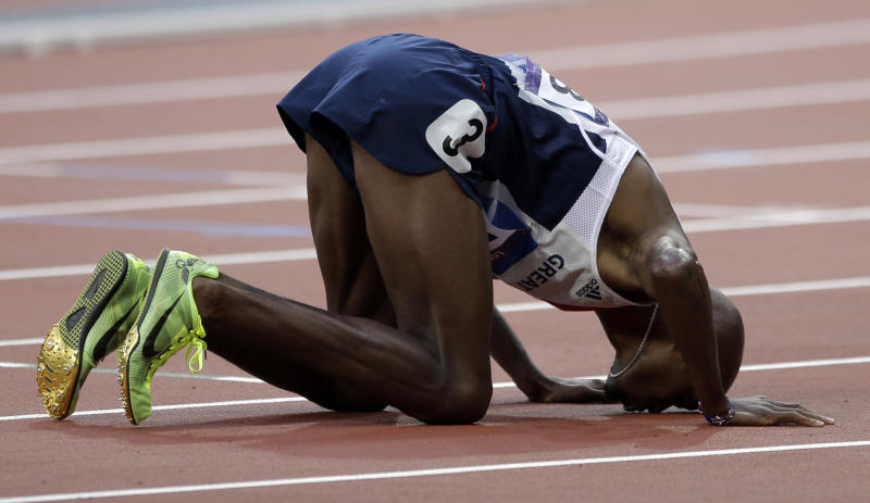 Great Britain's Mohamed Farah reacts after winning the gold in the men's 5000-meter final during the athletics in the Olympic Stadium at the 2012 Summer Olympics, London, Saturday, Aug. 11, 2012. (AP Photo/Matt Slocum)
