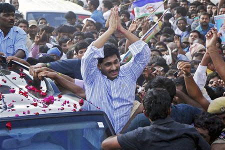 Leader of YSR Congress party Reddy gestures to his supporters after he was released on bail from Chanchalguda central prison in Hyderabad