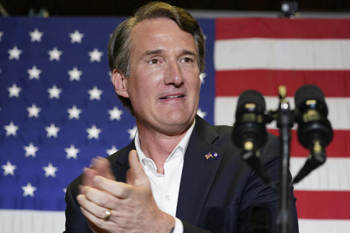 Republican gubernatorial candidate, Glen Youngkin, prepares to address the crowd at an event in Richmond, Va., Tuesday, May 11, 2021. (AP Photo/Steve Helber)