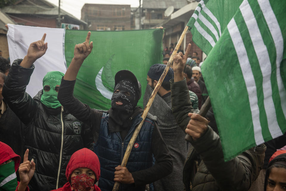 Masked Kashmiris shout slogans during a protest after Friday prayers on the outskirts of Srinagar, Indian controlled Kashmir, Oct. 4, 2019. The image was part of a series of photographs by Associated Press photographers which won the 2020 Pulitzer Prize for Feature Photography. (AP Photo/Dar Yasin)