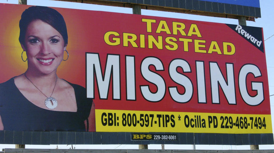 FILE - In this Oct. 4, 2006 file photo, an image of Tara Grinstead is displayed on a billboard in Ocilla, Ga. Georgia's highest court opened a door Monday, March 15, 2021, for taxpayer funds to help cover the legal defense of Ryan Duke, who is awaiting trial for the 2005 slaying of the high school teacher whose disappearance remained a mystery for more than a decade. (AP Photo/Elliott Minor, File)