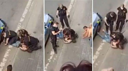 """<span class=""""caption"""">Footage showing Stanislav Tomáš being restrained by three policemen in Teplice, Czech Republic.</span> <span class=""""attribution""""><span class=""""source"""">YouTube/ROMEA TV</span></span>"""