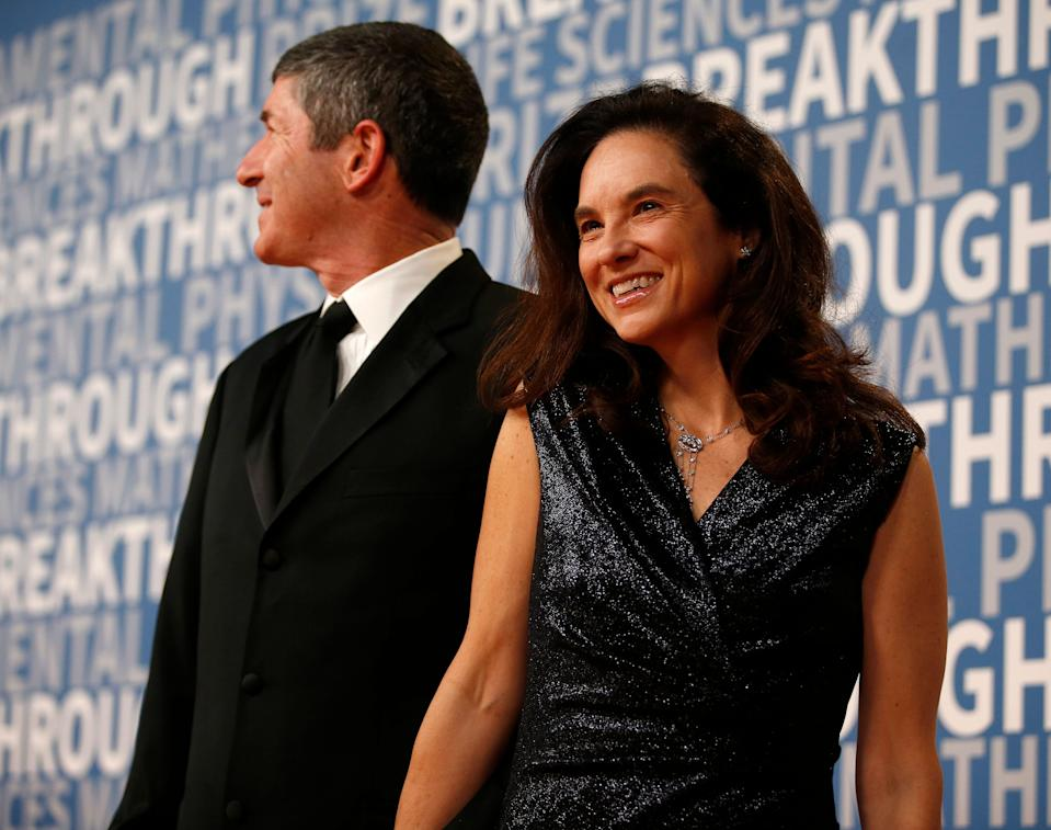 Caryn Marooney, right, vice president of technology communications at Facebook, poses for a picture on the red carpet for the 6th annual 2018 Breakthrough Prizes at Moffett Federal Airfield, Hangar One in Mountain View, Calif., on Sunday, Dec. 3, 2017. (Nhat V. Meyer/Bay Area News Group)(Digital First Media Group/Bay Area News via Getty Images)