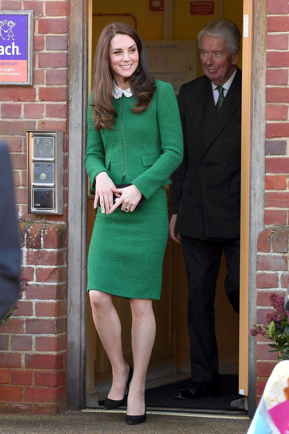 <p>The Duchess of Cambridge wears a green tweed skirt suit by Hobbs, black suede pumps by Gianvito Rossi and a black clutch while visiting East Anglia's Children's Hospice in Norfolk, England.</p>