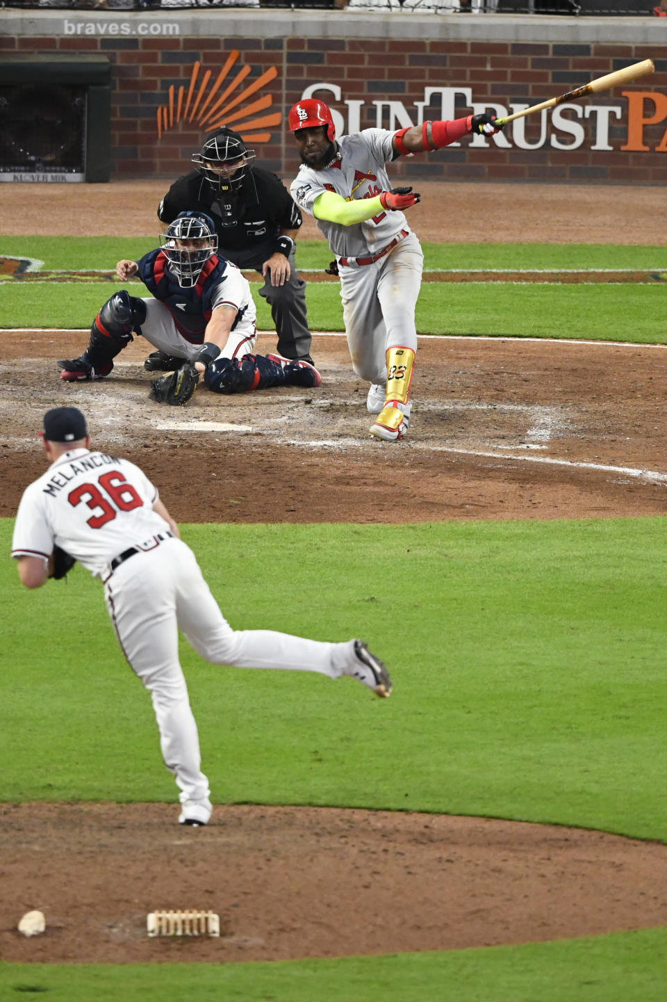 St. Louis Cardinals left fielder Marcell Ozuna (23) hits a two RBI double against the Atlanta Braves in the ninth inning during Game 1 of a best-of-five National League Division Series, Thursday, Oct. 3, 2019, in Atlanta. (AP Photo/Scott Cunningham)