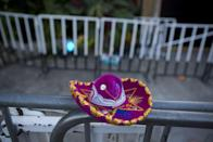A Mexican tourist souvenir placed by a well-wisher sits on barriers blocking the entrance to the Blue Parrot club, where several people were killed in early morning gunfire, in Playa del Carmen, Mexico, Monday, Jan. 16, 2017. Deadly gunfire broke out in the crowded beachfront nightclub throbbing with electronic music before dawn on Monday, setting off a bloody stamped by screaming concertgoers at an international festival in this Caribbean resort.(AP Photo/Rebecca Blackwell)