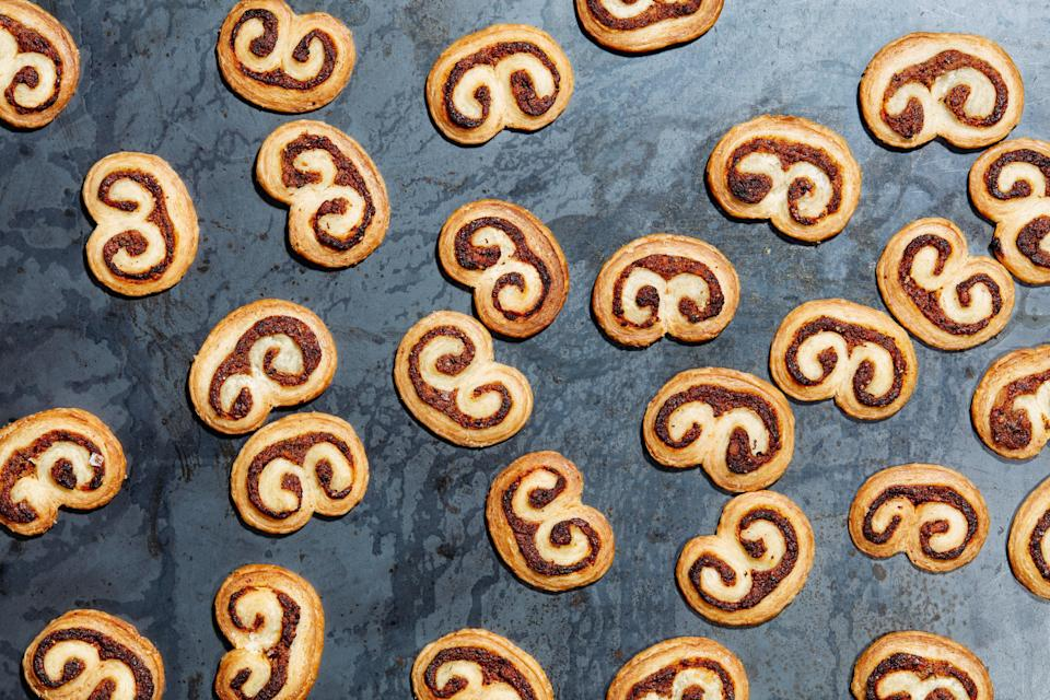 """Store-bought <a href=""""https://www.epicurious.com/recipes-menus/ways-to-use-puff-pastry-recipes-gallery?mbid=synd_yahoo_rss"""" rel=""""nofollow noopener"""" target=""""_blank"""" data-ylk=""""slk:puff pastry"""" class=""""link rapid-noclick-resp"""">puff pastry</a> makes these savory """"elephant ears"""" an easy bite-sized appetizer. <a href=""""https://www.epicurious.com/recipes/food/views/savory-mushroom-and-parmesan-palmiers?mbid=synd_yahoo_rss"""" rel=""""nofollow noopener"""" target=""""_blank"""" data-ylk=""""slk:See recipe."""" class=""""link rapid-noclick-resp"""">See recipe.</a>"""