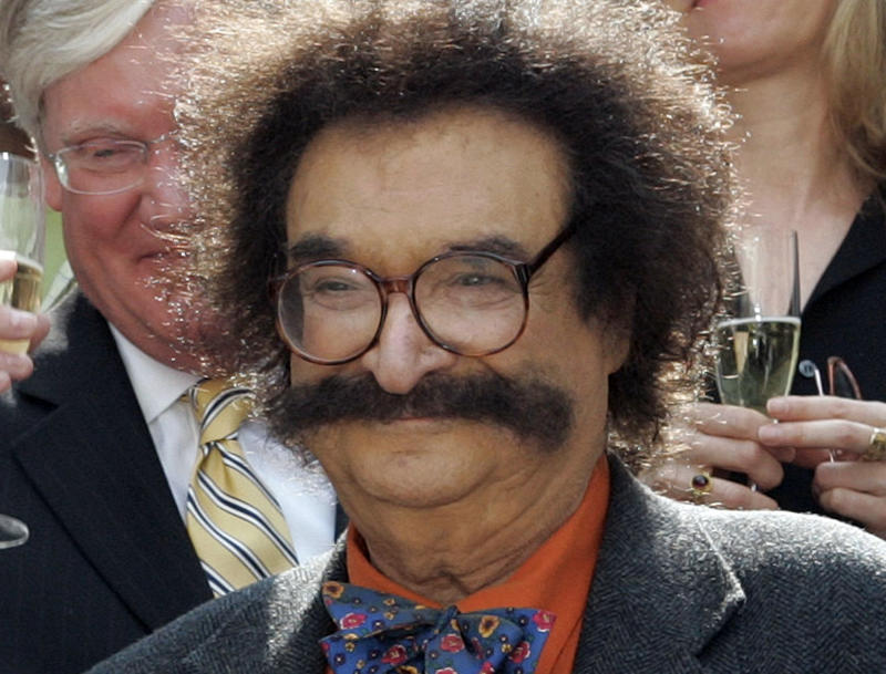 """FILE - In this May 31, 2006 file photo, film critic Gene Shalit is seen during a toast with """"Today"""" show cast and crew at the end of Katie Couric's final show, in New York.  Shalit, 86, faces a charge of driving to endanger after his vehicle struck a utility pole and came to rest against a home in Lenox, Mass., Wednesday, Oct. 24, 2012, according to police.  (AP Photo/Richard Drew, File)"""