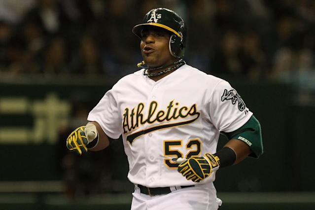 TOKYO, JAPAN - MARCH 29: Yoenis Cespedes #52 of the Oakland Athletics celebrates as he runs home after hitting a two run homer in the seventh inning against the Seattle Mariners during the MLB Opening Series game two between the Seattle Mariners and Oakland Athletics at Tokyo Dome on March 29, 2012 in Tokyo, Japan. (Photo by Chris McGrath/Getty Images)