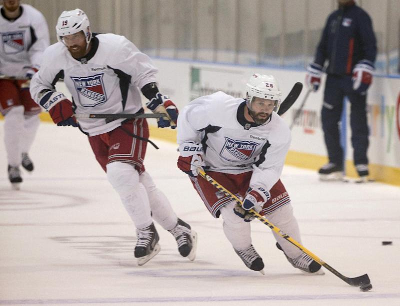 New York Rangers right wing Martin St. Louis (26) takes the puck up ice with center Brad Richards (19) during practice, Monday, June 2, 2014, in Greenburgh, N.Y. The Rangers will face the Los Angeles Kings in Game 1 of Stanley Cup Final in Los Angeles on Wednesday